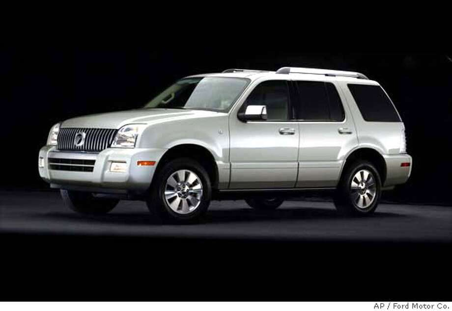 ** FILE **In a photo provided by the Ford Motor Co., a 2006 Mercury Mountaineer is shown in an undated photo. Ford Motor Co. is recalling about 235,000 pickups, vans and sport utility vehicles from the 2006 model year because of potential problems with the windshield wiper motor. The models include the E-150, E-250, E-350 and E-450 vans, the Escape, Expedition and Explorer SUVs, F-150 and Ranger pickups and Taurus sedan. It also includes the Lincoln Navigator SUV and Lincoln Mark LT pickup and Mercury Mountaineer and Mariner SUV. (AP Photo/Ford Motor Co., HO) PHOTO PROVIDED BY THE FORD MOTO CO Photo: Ap