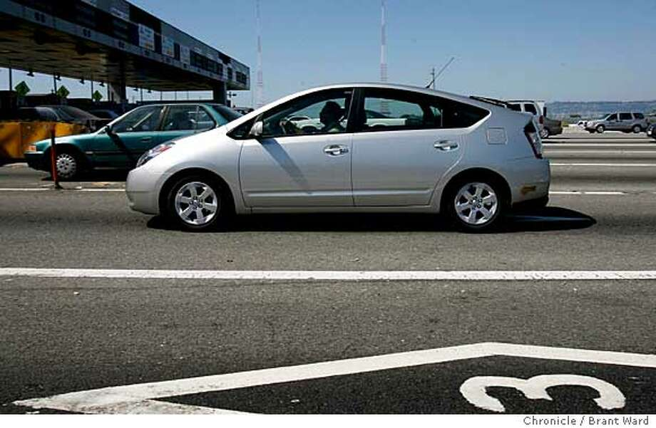 hybrid114.jpg  A Toyota Prius hybrid avoids paying a toll at the Bay Bridge with one person in the car during commute hours without the regularly required three passengers.  The popularity of certain hybrids has caused the numbers of HOV permits to soar. Californians considering a hybrid because of their HOV lane status should hurry up and buy.  {Brant Ward/The Chronicle} 8/14/06 Ran on: 09-08-2006  Toyota's Prius hybrid will pay back its $1,400 extra cost on the original purchase in 2.1 years, according to Edmunds analyst Alex Rosten. Photo: Brant Ward