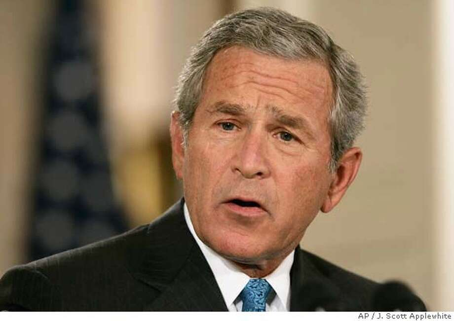 President Bush delivers a speech on terrorism in the East Room of the White House in Washington Wednesday, Sept. 6, 2006. Bush acknowledged the existence of previously secret CIA prisons around the world and said 14 high-value terrorism suspects, including the mastermind of the Sept. 11 attacks, have been transferred from the system to Guantanamo Bay for trials. (AP Photo/J. Scott Applewhite) Photo: J. SCOTT APPLEWHITE