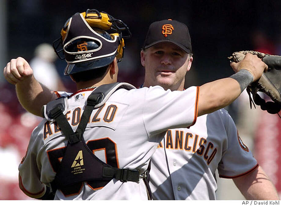 San Francisco Giants closer Mike Stanton, right, is congratulated by catcher Eliezer Alfonzo in the ninth inning of a baseball game, Wednesday, Sept. 6, 2006, in Cincinnati. Stanton pitched a perfect ninth for his seventh save in nine chances, as the Giants won 3-2. (AP Photo/David Kohl) Photo: DAVID KOHL
