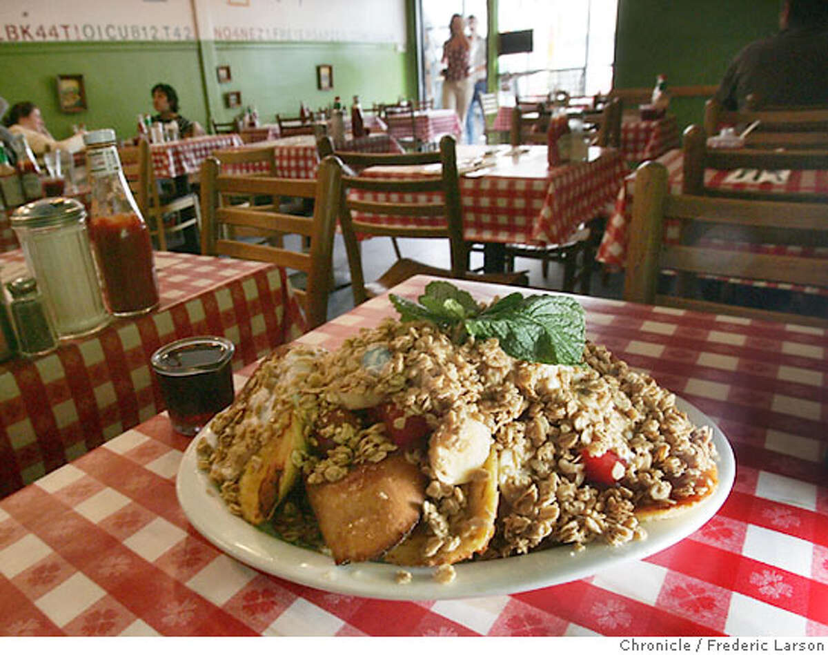 """Kate's Kitchen at 471 Haight Street near Filmore is a funky little cafe, nice young hip wait staff and has a """"French Toast Orgy,"""" with vermont maple syrup, orange spice french toast with fresh fruit, yogurt, granola and honey for $8. 9/1/06 {Frederic Larson/The Chronicle }"""