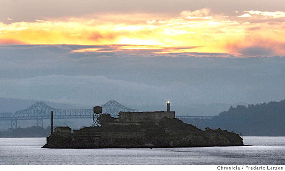 {object name} Sunday morning woke up to the sunny skies after a spell of cold wet snowy weather. Alcatraz Island was the focal point of the sun rising over its lighthouse viewed eastward from shore of Sausalito. 2/20/06  Frederic Larson Photo: Frederic Larson