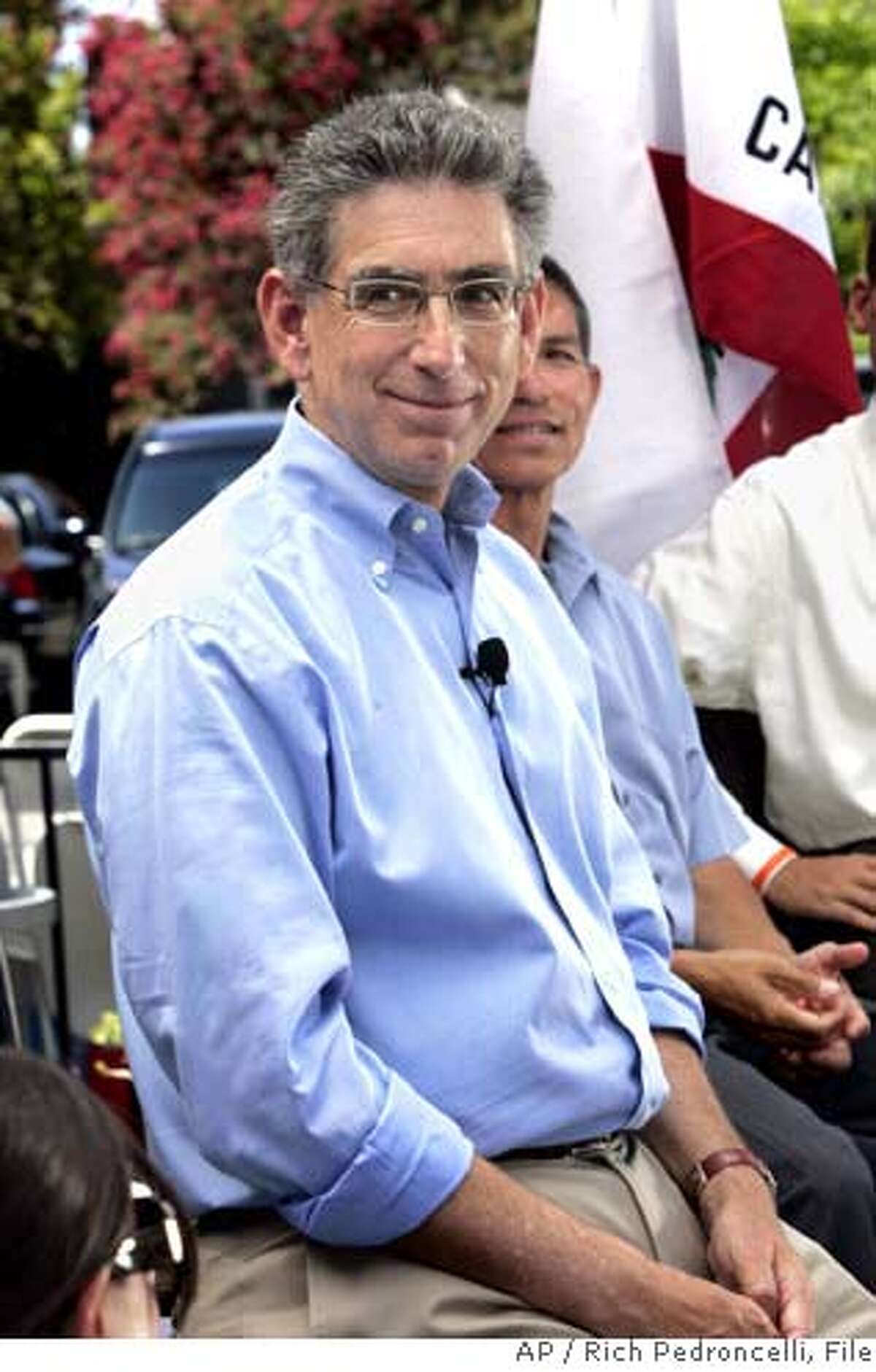 ** ADVANCE FOR SUNDAY SEPT. 3 ** FILE ** Democratic gubernatorial candidate Phil Angelides, smiles as he listens to a questions during an open forum campaign event in Sacramento, Calif., Monday, Aug. 21, 2006. A recent poll by the Public Policy Institute of California showed Angelides trailing his opponent, incumbent Republican Gov. Arnold Schwarzenegger by 13 points. In an effort to revamp his image he has dumped his staid suit and tie in favor of open collared shirts and adopted a more casual tone.(AP Photo/Rich Pedroncelli, file) ADVANCE FOR SUNDAY SEPT. 3 AUG. 21, 2006 FILE PHOTO