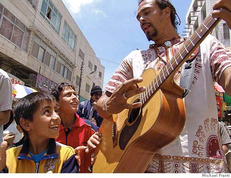 "Michael Franti's film, ""I Know I'm Not Alone"", will be shown at the Bernal Heights Outdoor Cinema event. Credit: Michael Franti  Ran on: 08-31-2006 Ran on: 08-31-2006  &quo;I Know I'm Not Alone,'' by Michael Franti, about his travels to Iraq, Israel and the Palestinian territories, will be shown at the Bernal Heights Outdoor Cinema event.  Ran on: 08-31-2006 Ran on: 08-31-2006 Ran on: 09-07-2006  Michael Franti's trip from San Francisco to Iraq is documented in the film &quo;I Know I'm Not Alone.&quo; He says he was the first American most Iraqis met who wasn't carrying a rifle. Photo: Michael Franti"