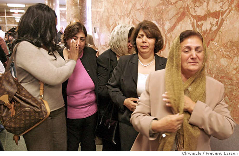 After the arraingment of Omeed Ariz Popal, Shonna Hall (far left), a niece of hit and run victim Leon Stevens, consoles a family member of the suspect as they walk out the Hall of Justice. (no names of Popal relatives available). *** Shonna Hall(cq)  9/6/06  {Frederic Larson/The Chronicle } Photo: Frederic Larson