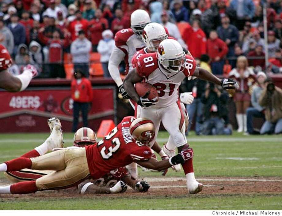 49ERS_371_MJM.jpg  Cardinals #81 Anquan Boldin breaks a tackle attempt by 49ers Derrick Johnson and runs to the endzone for a 4th quarter td.  SF 49ers vs Arizona Cardinals at Monster park.  Event in San Francisco, CA  Photo by Michael Maloney / The Chronicle Ran on: 12-06-2005  Mike Adams had the best chance at tackling Anquan Boldin on the game-winning play Sunday. Ran on: 12-06-2005  Mike Adams had the best chance at tackling Anquan Boldin on the game-winning play Sunday. MANDATORY CREDIT FOR PHOTOG AND SF CHRONICLE/ -MAGS OUT Photo: Michael Maloney