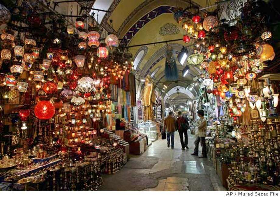 **FOR IMMEDIATE RELEASE** Visitors stroll through the Ottoman era Grand Bazaar in Istanbul, Turkey, Sept. 27, 2005. (AP Photo/Murad Sezer) FOR IMMEDIATE RELEASE. Photo: MURAD SEZER