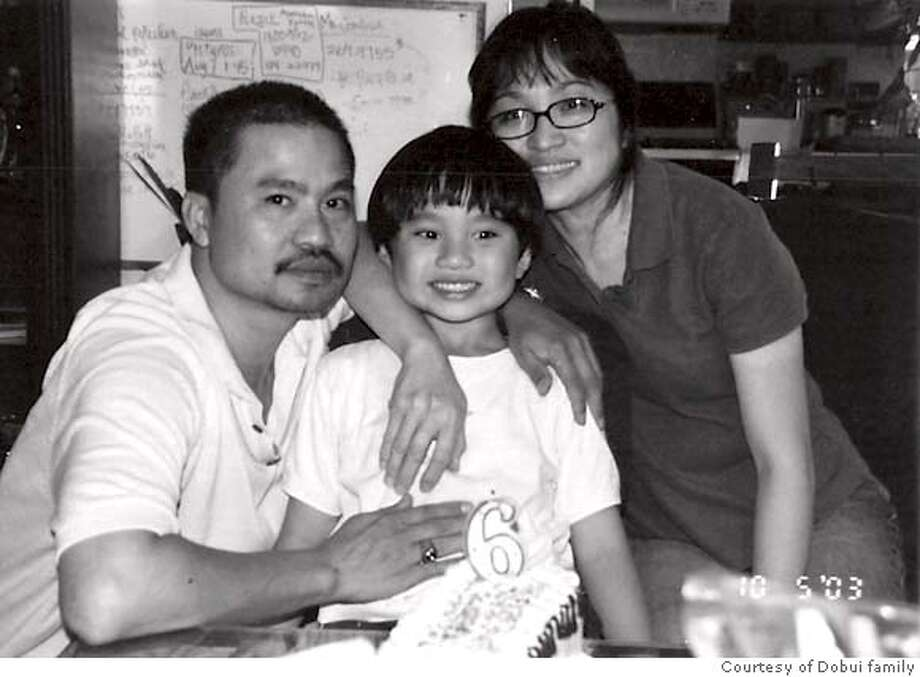 Cong Thanh Do, left, a San Jose�engineer and�human rights activist,�was�arrested on�August 14 in Phan Thiet, a coastal city in Central Vietnam. Photo includes him, his wife Jane Dobui, 48 and his youngest son, Nien Dobui, 9. It was taken in their home in San Jose, CA in 2004. Courtesy of Dobui family Photo: Dobui Family