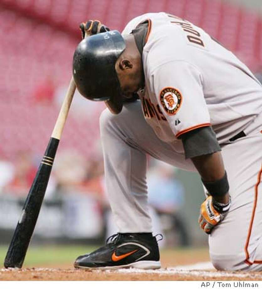 San Francisco Giants Ray Durham kneels at the plate after hitting a foul ball off his foot in the second inning of a baseball game with the Cincinnati Reds, Tuesday, Sept. 5, 2006, in Cincinnati. Durham stayed in the game won by the Reds, 3-0. (AP Photo/Tom Uhlman) Photo: TOM UHLMAN