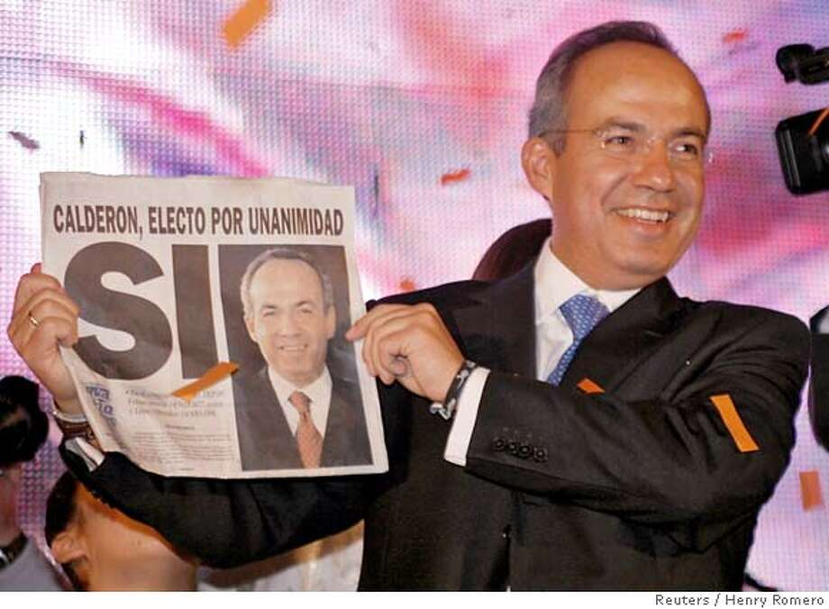 "Felipe Calderon, Mexico's president-elect, holds up a newspaper front page with the word ""Yes"" in Spanish during celebrations at his National Action Party (PAN) headquarters in Mexico City after the federal electoral tribunal declared him to be the winner of the presidential elections September 5, 2006. REUTERS/Henry Romero(MEXICO) 0 Photo: HENRY ROMERO"