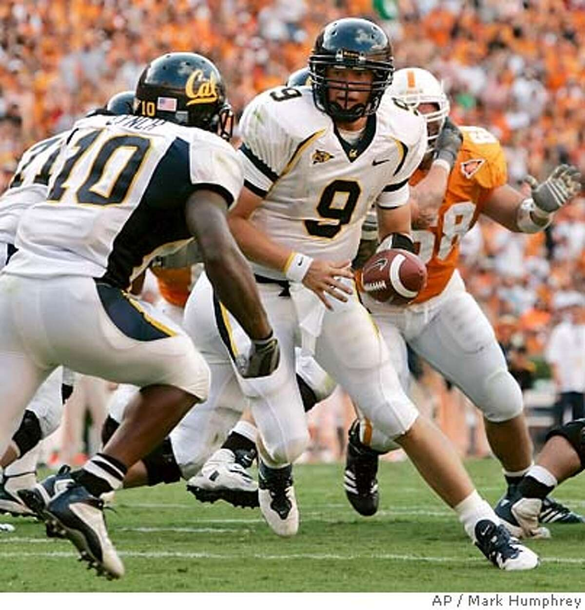 California quarterback Nate Longshore (9)hands off to tailback Marshawn Lynch (10) in the second quarter of their college football game against Tennessee on Saturday, Sept. 2, 2006, in Knoxville, Tenn. Tennessee upset California, 35-18. (AP Photo/Mark Humphrey)