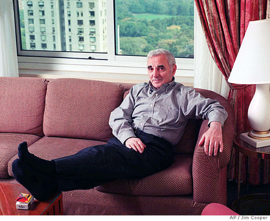 ADVANCE FOR WEEKEND EDITIONS, NOV. 20-22--French singer Charles Aznavour poses in his New York hotel room Oct. 14, 1998. At age 74, Aznavour remains an active performer, singing frequently in concert and acting in several films a year.(AP Photo/Jim Cooper)  Ran on: 07-02-2006 Ran on: 09-06-2006  Entertainer Charles Aznavour's career spans nearly six decades. Photo: JIM COOPER