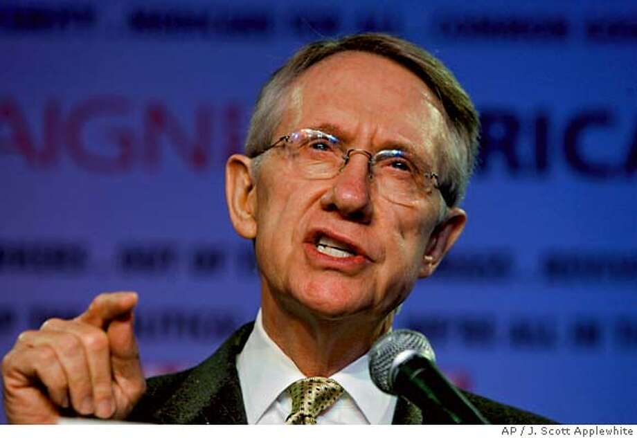 Senate Minority Leader Harry Reid of Nev., gestures during a speech before an environmentalist audience meeting in Washington, Monday, June 12, 2006 where he sharply criticized President Bush on the war in Iraq, The gathering was focused on a campaign to rid America of its oil dependency, but Reid spent much of his time blasting the Bush administration on the Middle East, gas prices, and failures over Hurricane Katrina. (AP Photo/J. Scott Applewhite)  Ran on: 06-21-2006 Ran on: 06-23-2006 Ran on: 08-04-2006  Harry Reid Photo: J. SCOTT APPLEWHITE
