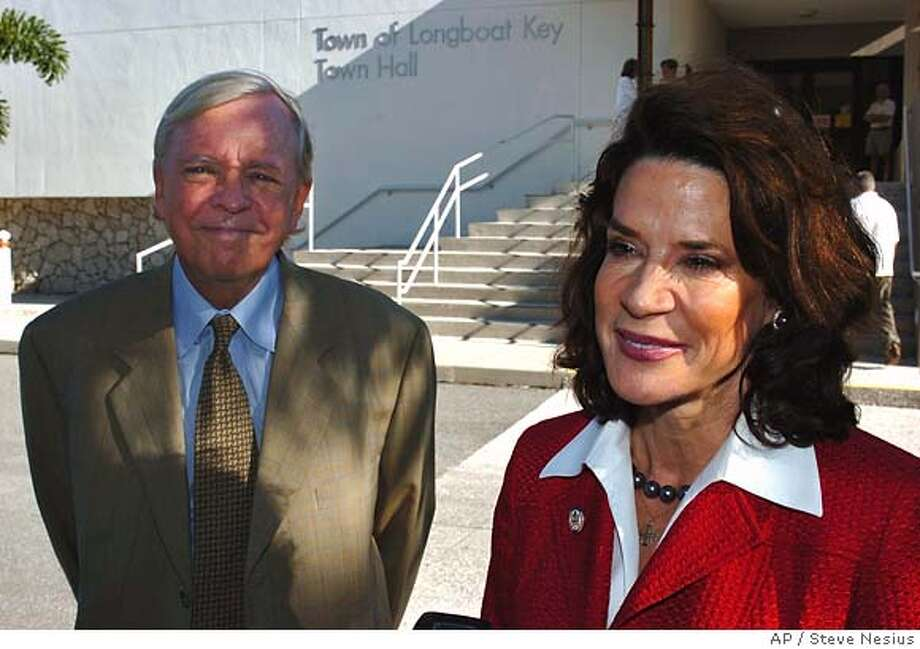 Republican Senate hopeful Rep. Katherine Harris and her husband, Anders Ebbeson, talk with reporters after voting in the primary elections Tuesday, Sept. 5, 2006 in Longboat Key, Fla. (AP Photo/Steve Nesius) Photo: STEVE NESIUS