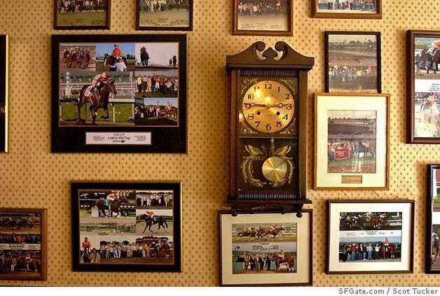 "Historical photographs and horsed that Harry Aleo owns adorn the walls of Twin Peaks Property. Harry Aleo, horse owner and horse racing afficionado, sits behind his desk at his office on Friday September 1, 2006. Aleo is the owner of Twin Peaks Property in Noe Valley in San Francisco. Since the unfortunate events of his horse ""Lost In The Fog"", Aleo has received stacks of touching letters, constant well-wishing phone-calls and condolences from passerby's.  He feels obligated to respond and give thanks back to the people because they took the time out of their lives to write him a letter or stop by his office and express their caring support. SFGate.com photo by Scot Tucker Photo: SFGate.com / Scot Tucker"