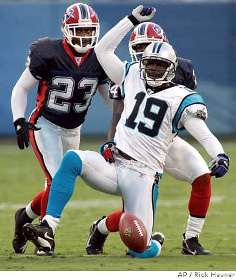 Carolina Panthers' Keyshawn Johnson (19) gestures after making a first-down catch, in front of Buffalo Bills' Troy Vincent (23) and Terrence McGee (24) during the first quarter of an NFL preseason NFL football game in Charlotte, N.C., Saturday Aug. 12, 2006. (AP Photo/Rick Havner) EFE OUT Photo: RICK HAVNER