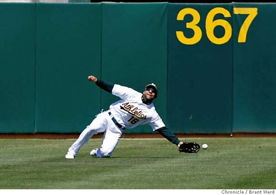athletics014.jpg  Left fielder Jay Payton can't handle a shot in the 2nd inning by Nelson Cruz that eventually ends up as an inside the park homerun.  The Oakland A's vs. Texas Rangers at McAfee Coliseum Monday, Labor Day.{Brant Ward/The Chronicle} 9/4/06 Photo: Brant Ward