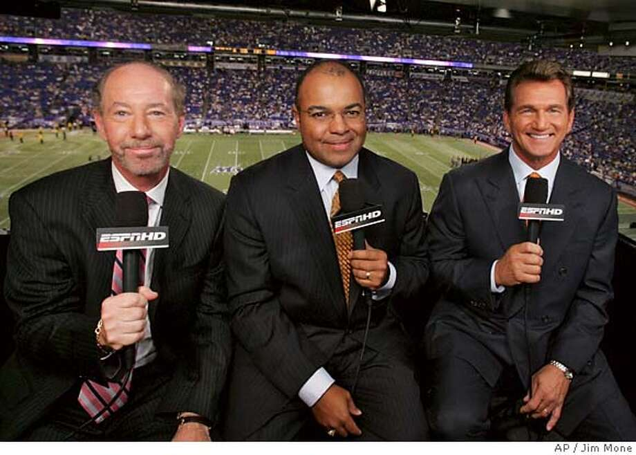 The new ESPN Monday Night Football television broadcast crew, from left Tony Kornheiser, Mike Tirico and Joe Theismann pose for a photo before the Oakland Raiders-Minnesota Vikings preseason game Monday, Aug. 14, 2006 in Minneapolis. (AP Photo/Jim Mone) Photo: JIM MONE