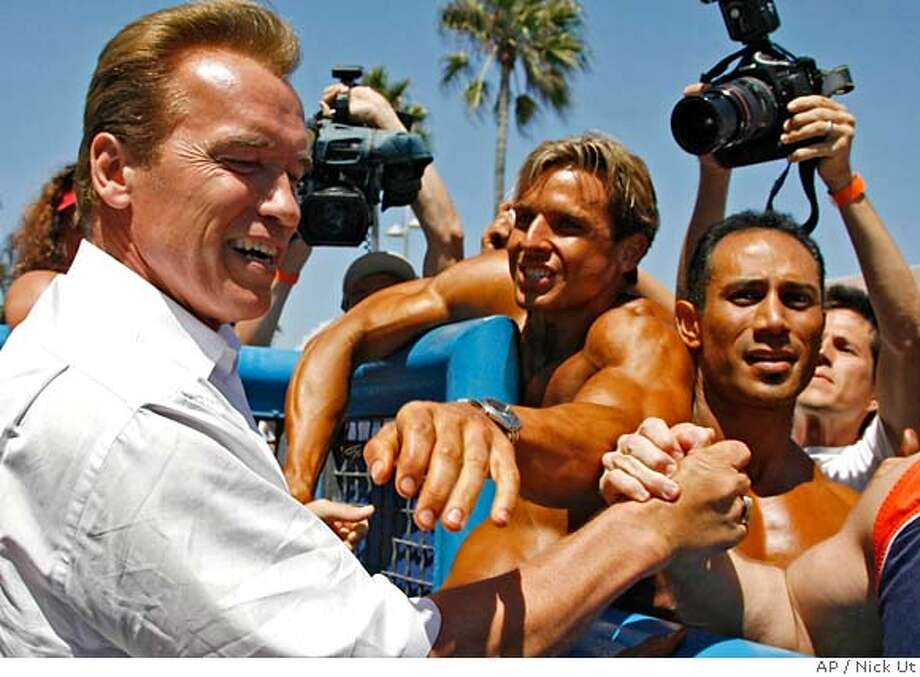 California Gov, Arnold Schwarzenegger is greeted by supporters in Venice Beach Calif, Sept. 4, 2006. (AP Photo/Nick Ut) Photo: NICK UT