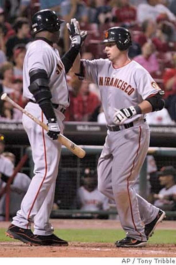 San Francisco Giants' Shea Hillenbrand, right, is congratulated by Barry Bonds, left, after Hillenbrand hit the go-ahead solo home run off Cincinnati Reds' pitcher David Weathers in the tenth inning during their baseball game, Monday, Sept. 4, 2006 in Cincinnati. The Giants won 5-4. (AP Photo/Tony Tribble) Photo: TONY TRIBBLE