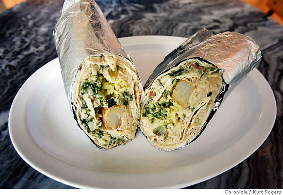 The Jericho wrap.  Yummma's Restaurant on Irving st between 8th and 9th Jamal Daibis (cq) makes a Jerusalem wrap.  KURT ROGERS /THE CHRONICLE SAN FRANCISCO THE CHRONICLE  SFC .jpg MANDATORY CREDIT FOR PHOTOG AND SF CHRONICLE / -MAGS OUT Photo: KURT ROGERS /THE CHRONICLE
