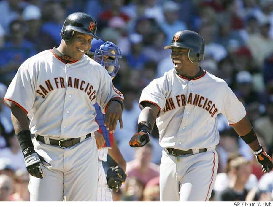 San Francisco Giants' Ray Durham, right, smiles as he celebrates with teammate Barry Bonds after Durham hit a two-run home run against the Chicago Cubs during the sixth inning of a baseball game at Wrigley Field on Saturday, Sept. 2, 2006, in Chicago. (AP Photo/Nam Y. Huh) EFE OUT Photo: NAM Y. HUH