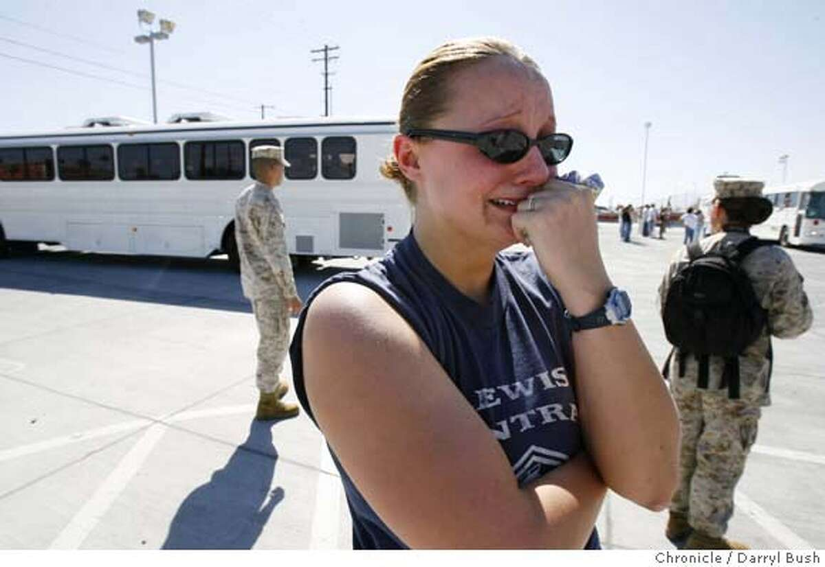 Sarah Bremmer, 20, from Woodbine, Iowa, cries, after her husband Petty Officer 3rd Class, James Bremmer, 23, (a Navy medic attached to the Marines), also of Woodbine, leaves in buses departing behind her, that are part of the 3rd Battalion 4th Marine Regiment, beginning their deployment to Iraq Thursday morning, at the Marine Corps Air Ground Combat Center Twentynine Palms, near Twentynine Palms, CA on Thursday, August 31, 2006. 8/31/06 Darryl Bush / The Chronicle ** Sarah Bremmer, James Bremmer(cq)