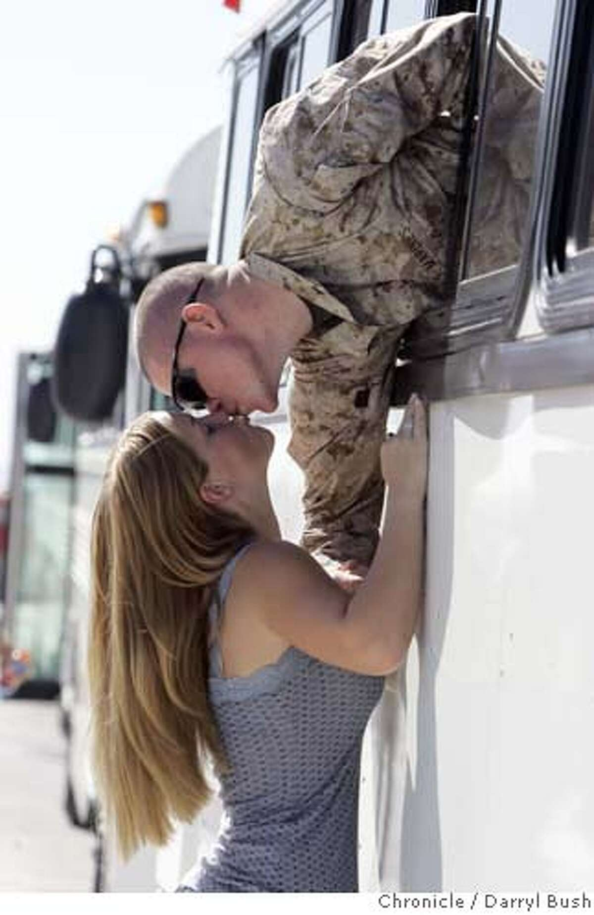 Kayla Judge, 17, kisses goodbye her boyfriend, Lance Corporal Shawn Patten, 19, both from Moreno Valley, CA., as he and other Marines from the 3rd Battalion 4th Marine Regiment, board buses that begin their deployment to Iraq Thursday morning, at the Marine Corps Air Ground Combat Center Twentynine Palms, near Twentynine Palms, CA on Thursday, August 31, 2006. 8/31/06 Darryl Bush / The Chronicle ** Kayla Judge, Shawn Patten (cq)