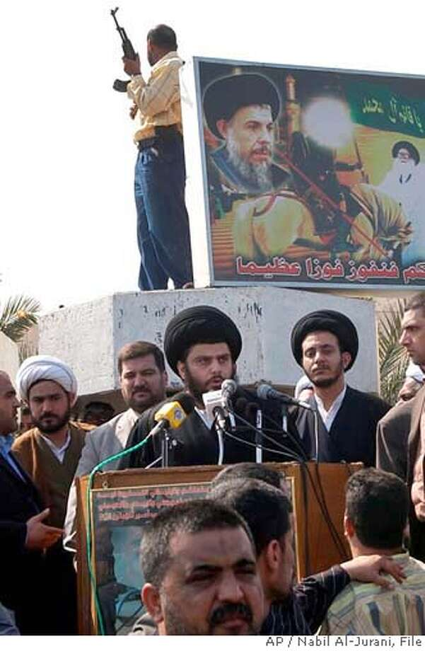 ** FILE ** Radical Shiite cleric Muqtada al-Sadr speaks to his supporters in Basra, 550 kilometers (340 miles) southeast of Baghdad, Iraq, Sunday, Feb. 26, 2006. Intense clashes between the Iraqi army and a Shiite militia which started Sunday, Aug. 28, 2006 are part of a strategy to whittle away the power of a radical cleric. But the high-risk gambit could trigger more fighting across the Shiite south _ at a time when the cleric's stronghold here is virtually off-limits. (AP Photo/Nabil Al-Jurani) Photo: NABIL AL-JURANI