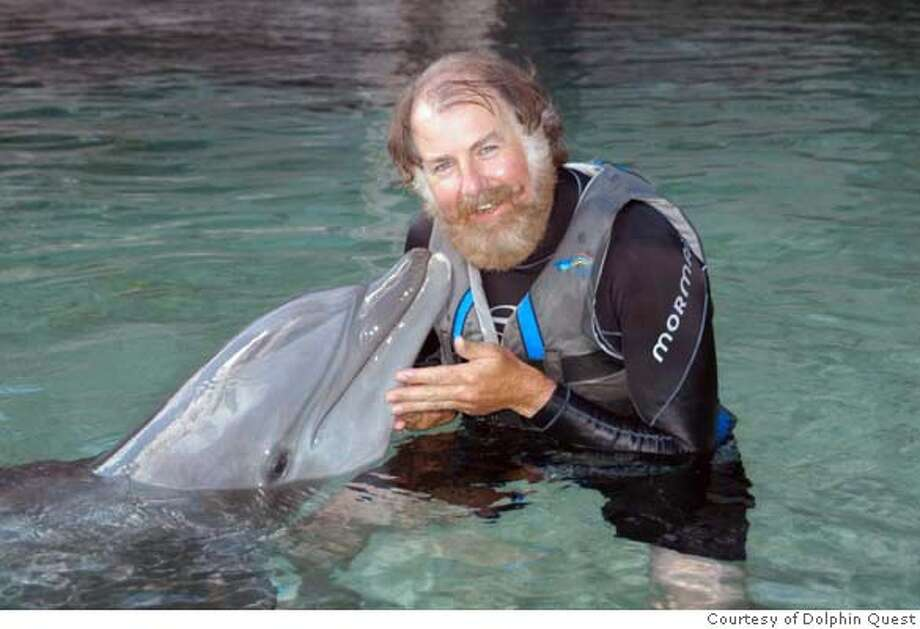 Lono, a bottlenose dolphin, nuzzles the Chronicle�s Tom Stienstra. Photo: Courtesy of Dolphin Quest Photo: Courtesy Of Dolphin Quest