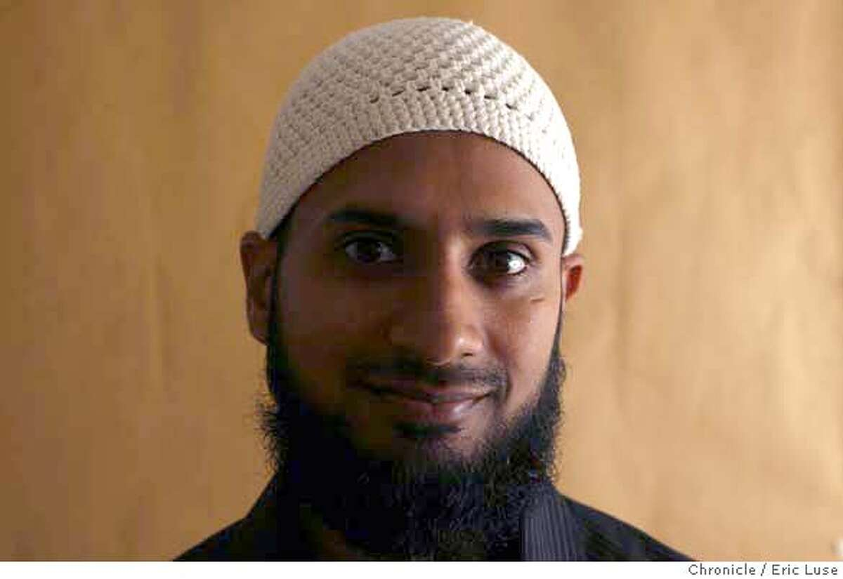 newrace_067_el.jpg Omair Ali became more religious after Sept. 11. He also adopted physical characteristics of the faith that aren't required to more affirmatively display his faith. He feels like being