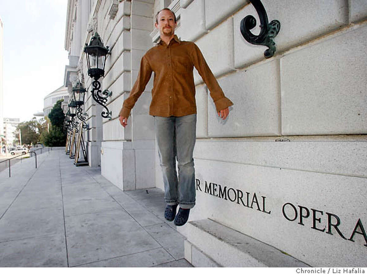 Former intern Justin Taylor gets the jump on the San Francisco Opera season in front of the War Memorial Opera House. Chronicle photo by Liz Hafalia