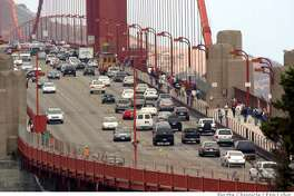 Motorists cross the Golden Gate Bridge Saturday, September 2, 2006. Bridges around the Bay Area are taking on extra traffic due to a weekend closure of the East Bound Bay Bridge for a retrofitting project. Event on 09/02/06 in San Francisco. Erin Lubin / For the Chronicle