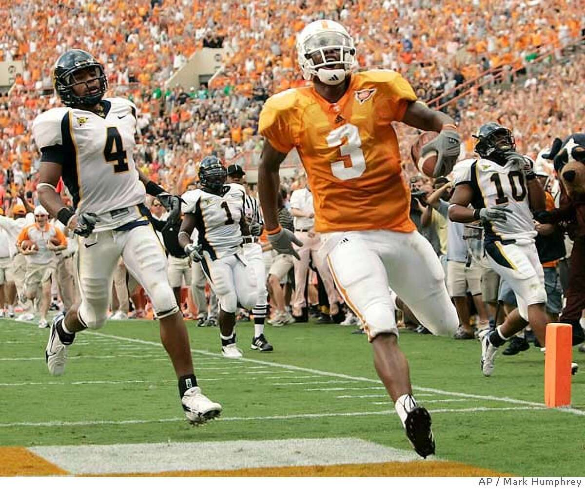 Tennessee wide receiver Robert Meachem (3) beats California's Thomas DeCoud (4), Worrell Williams (1) and Desmond Bishop (10) to the end zone as he scores a touchdown in the second quarter of their college football game on Saturday, Sept. 2, 2006, in Knoxville, Tenn. (AP Photo/Mark Humphrey)