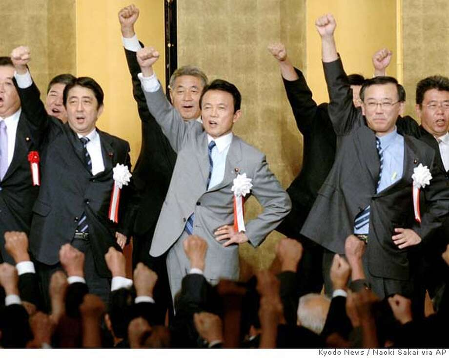Three major contenders for the ruling Liberal Democratic Party presidential election, from left, Chief Cabinet Secretary Shinzo Abe, Foreign Minister Taro Aso and Finance Minister Sadakazu Tanigaki, punch their air with their fists at a convention of the Liberal Democratic Party's regional chapter at Hiroshima, western Japan, on Friday September 1, 2006. Shinzo Abe, the nationalist front-runner to be Japan's next prime minister, announced his candidacy Friday, promising to defend Japan's interests and maintain the security alliance with the United States. Abe is hugely popular, consistently leading all contenders in popularity polls. His rivals _ Finance Minister Sadakazu Tanigaki and Foreign Minister Taro Aso _ have yet to mount serious challenges to his lead. (AP Photo/Kyodo News, Naoki Sakai) ** JAPAN OUT MANDATORY CREDIT ** Photo: NAOKI SAKAI