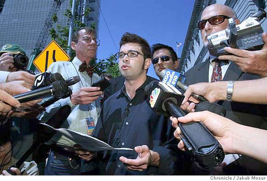 Wolf_03_JMM.JPG  Josh Wolf, freelance journalist who went to jail for refusing to turn over his video of a 2005 SF protest to a grand jury, gives a press conference after a federal appeals court sprung him on bail outside the U.S. Court of Appeals for the 9th Circuit Building in San Francisco on Friday. Event on 9/1/06 in San Frnacisco. JAKUB MOSUR / The Chronicle  Ran on: 09-02-2006  Josh Wolf, (center) who refused to give his unaired video of a 2005 protest to a federal grand jury, is free to resume his online work. Photo: JAKUB MOSUR