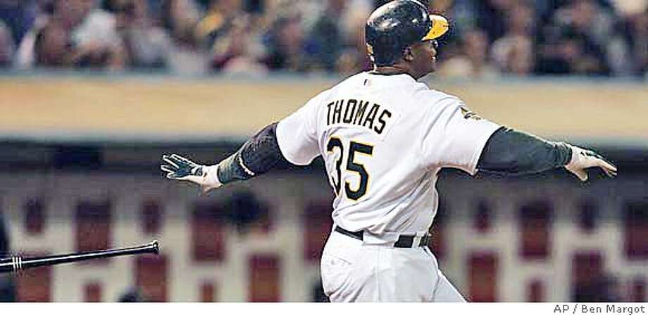 Oakland Athletics' Frank Thomas releases his bat after hitting a two-run home run off Baltimore Orioles' Todd Williams in the seventh inning of a baseball game Friday, Sept. 1, 2006, in Oakland, Calif. (AP Photo/Ben Margot) Photo: BEN MARGOT