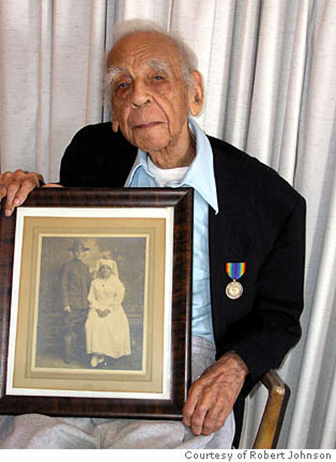 Obituary photo of George Johnson. He was the oldest Californian and last surviving WW I Veteran in California. Credit: Robert Johnson  Ran on: 09-02-2006  George Johnson holds a 1918 picture of himself and his mother in this 2005 photo, which was taken on his 111th birthday.  Ran on: 09-02-2006 Ran on: 09-02-2006 Ran on: 09-02-2006 Photo: Robert Johnson