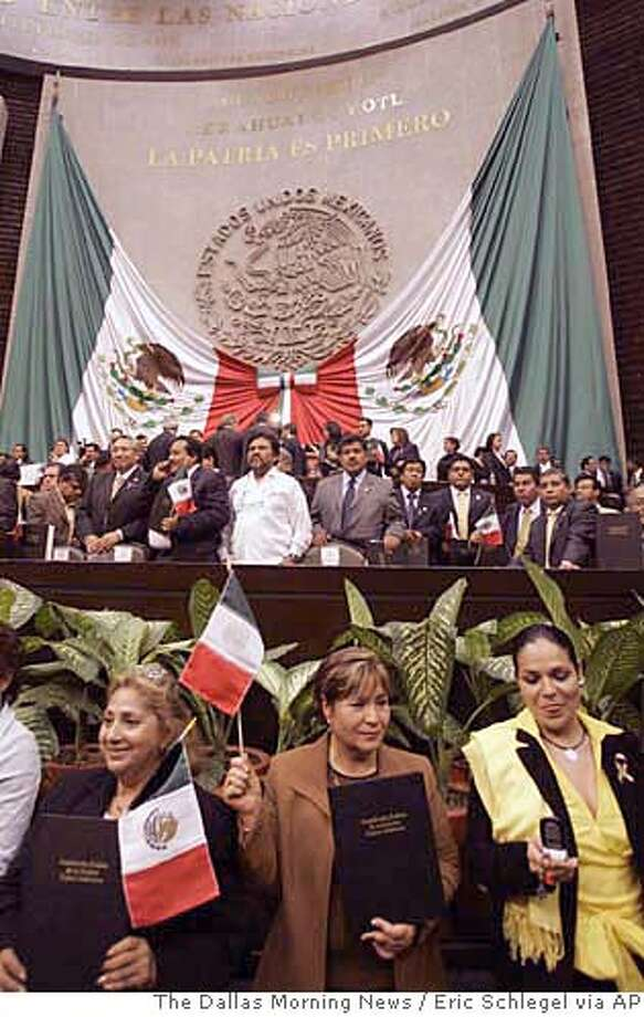 Leftist lawmakers storm the stage of Congress to protest the disputed July 2 elections prior to the arrival of Mexican president Vicente Fox, Friday Sept. 1, 2006, in Mexico City, Mexico. Fox, who was expected to deliver his sixth and last state-of-the nation address, instead handed in a written copy of his address and his office said he would address the nation in a televised speech later in the evening. It was the first time in modern Mexican history a president hasn't given the annual address to Congress. (AP Photo/The Dallas Morning News, Eric Schlegel) ** MANDATORY CREDIT, , MAGS OUT, TV OUT, INTERNET: AP MEMBERS ONLY ** EFE OUT MANDATORY CREDIT, , MAGS OUT, TV OUT, INTERNET: AP MEMBERS ONLY Photo: ERICH SCHLEGEL