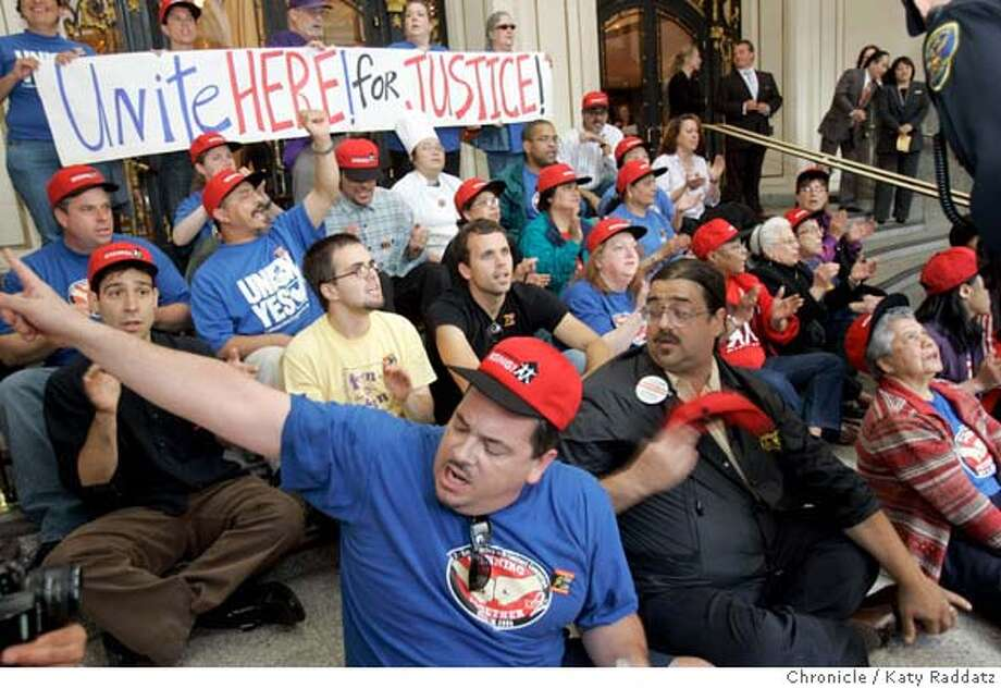 HOTELS_168_RAD.jpg  SHOWN: Members of Local 2 of Unite Here, the hotel workers' union, gather at the Four Seasons Hotel on Market St., then march down Market and turn onto New Montgomery St. to the Palace Hotel, where many of them engage in civil disobedience by sitting on the front steps to the Palace Hotel, and get arrested. These photos made on Thursday, Aug. 31, 2006, in San Francisco, CA. (Katy Raddatz/The S.F.Chronicle)  ** Mandatory credit for photographer and the San Francisco Chronicle/ -Mags out Photo: Katy Raddatz
