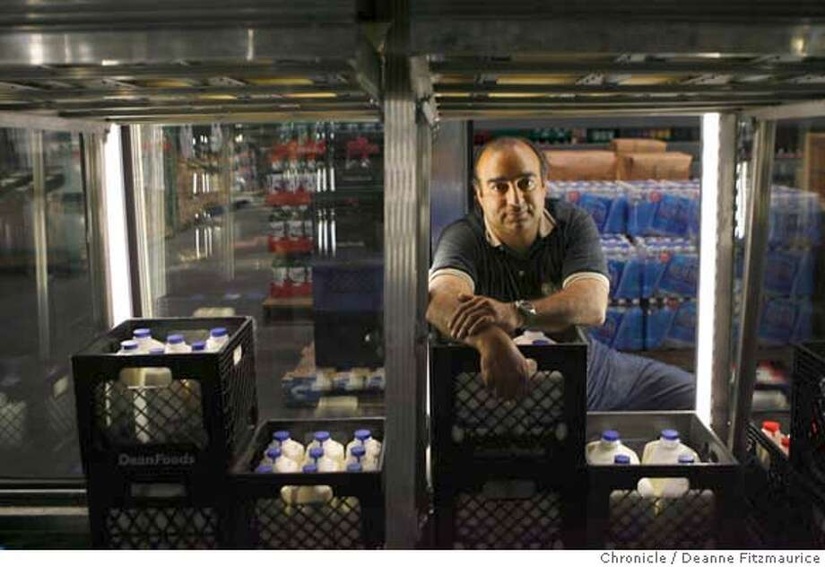 energy02_0031_df.jpg  George Nasrah is the manager of Geary Wholesale Company. He is part of a program where he has agreed to cut power such as the lights in the refrigerators when there is an energy crunch. Photographed in San Francisco on 8/31/06.  (Deanne Fitzmaurice/ The Chronicle) Mandatory credit for photographer and San Francisco Chronicle. /Magazines out. Photo: Deanne Fitzmaurice