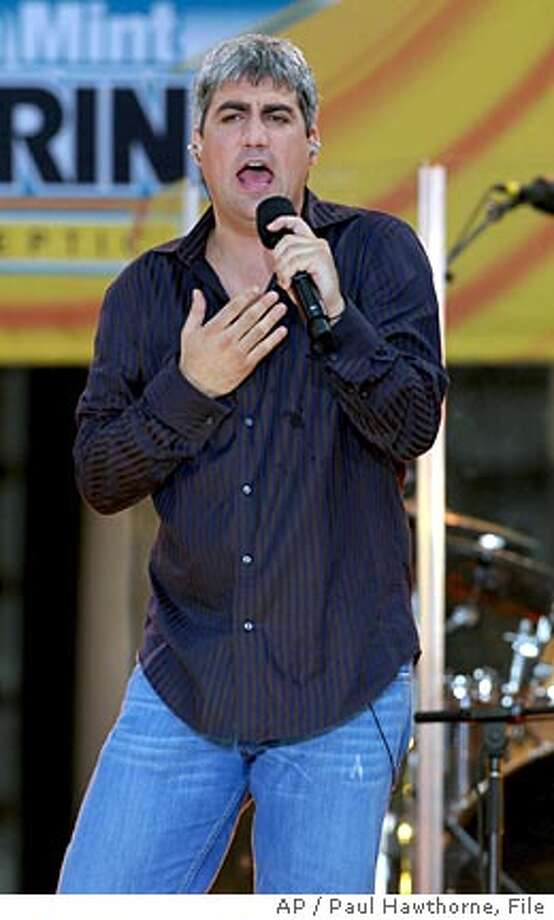 "**FILE** Taylor Hicks, winner of the most recent ""American Idol"" television talent competion, performs on stage during ABC's ""Good Morning America"" summer concert series in New York, in this file photo from July 21, 2006. Hicks and a Nashville producer have settled a lawsuit filed by the ""American Idol"" winner over the rights to three songs he wrote and recorded before becoming a phenom on the TV talent show, court documents showed Tuesday, Aug. 29, 2006. (AP Photo/Paul Hawthorne-File) Photo: PAUL HAWTHORNE"