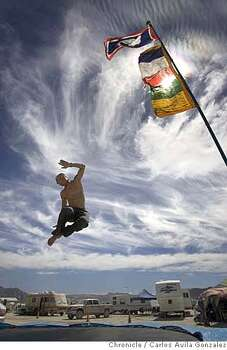 Rob Whittal of Salt Lake City, Ut., gets some air on a trampoline at his camp at Burning Man 2006.  Photo: Carlos Avila Gonzalez