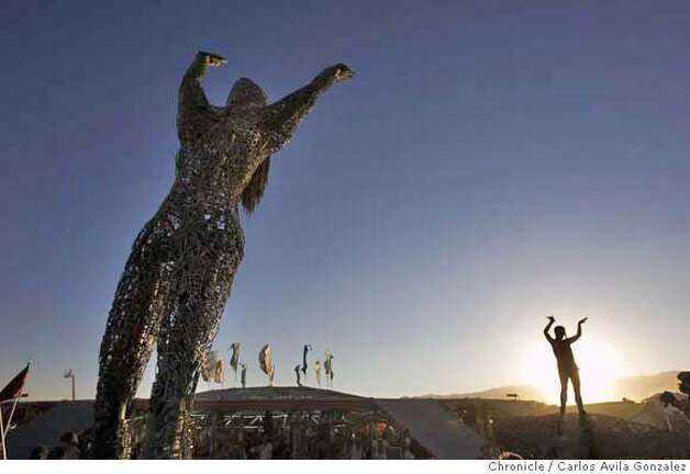 A Burning Man participant dances near a sculpture at Center Camp during the Burning Man Festival on Tuesday, August 29, 2006. Daily coverage of the Burning Man festival in the Nevada desert. Photo by Carlos Avila Gonzalez/The San Francisco Chronicle  Photo taken on 8/29/06, in Black Rock City, Nv, USA  **All names cq (source) Photo: Carlos Avila Gonzalez