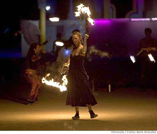 Rebecca Roth of Bend, Oregon, practices fire dancing on Thursday night, August 31, 2006, in preparation for a performance at the Burning Man Festival in the Nevada Desert. Daily coverage of the Burning Man festival in the Nevada desert. Photo by Carlos Avila Gonzalez/The San Francisco Chronicle  Photo taken on 8/31/06, in Black Rock City, Nv, USA  **All names cq (source) Photo: Carlos Avila Gonzalez