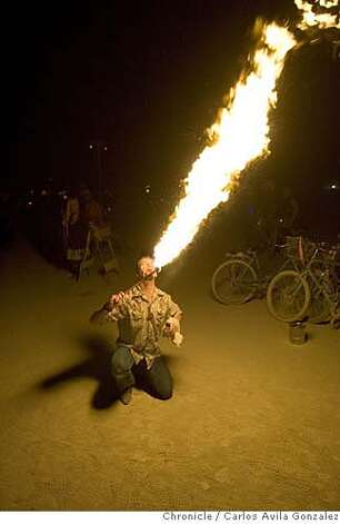 Chris Alongi of Oakland, Ca., practices his fire breathing on the Playa on Thursday, August 31, 2006, during the Burning Man Festival. Daily coverage of the Burning Man festival in the Nevada desert. Photo by Carlos Avila Gonzalez/The San Francisco Chronicle  Photo taken on 8/31/06, in Black Rock City, Nv, USA  **All names cq (source) Photo: Carlos Avila Gonzalez