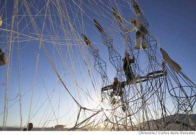 Burning Man Participants climb on the art structure, Cat's Cradle on the Playa on Friday, September 1, 2006. Daily coverage of the Burning Man festival in the Nevada desert. Photo by Carlos Avila Gonzalez/The San Francisco Chronicle  Photo taken on 9/1/06, in Black Rock City, Nv, USA  **All names cq (source) Photo: Carlos Avila Gonzalez