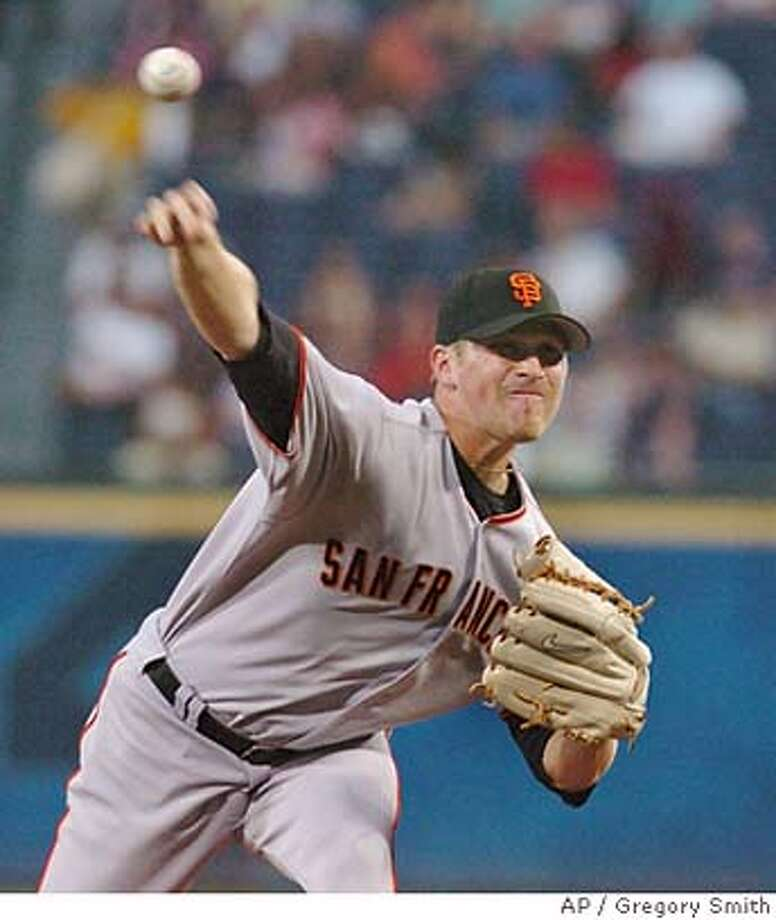 San Francisco Giants starter Brad Hennessey delivers to the Atlanta Braves during the first inning of a Major League Baseball game, Wednesday, Aug. 30, 2006, at Turner Field in Atlanta. (AP Photo/Gregory Smith) Photo: GREGORY SMITH
