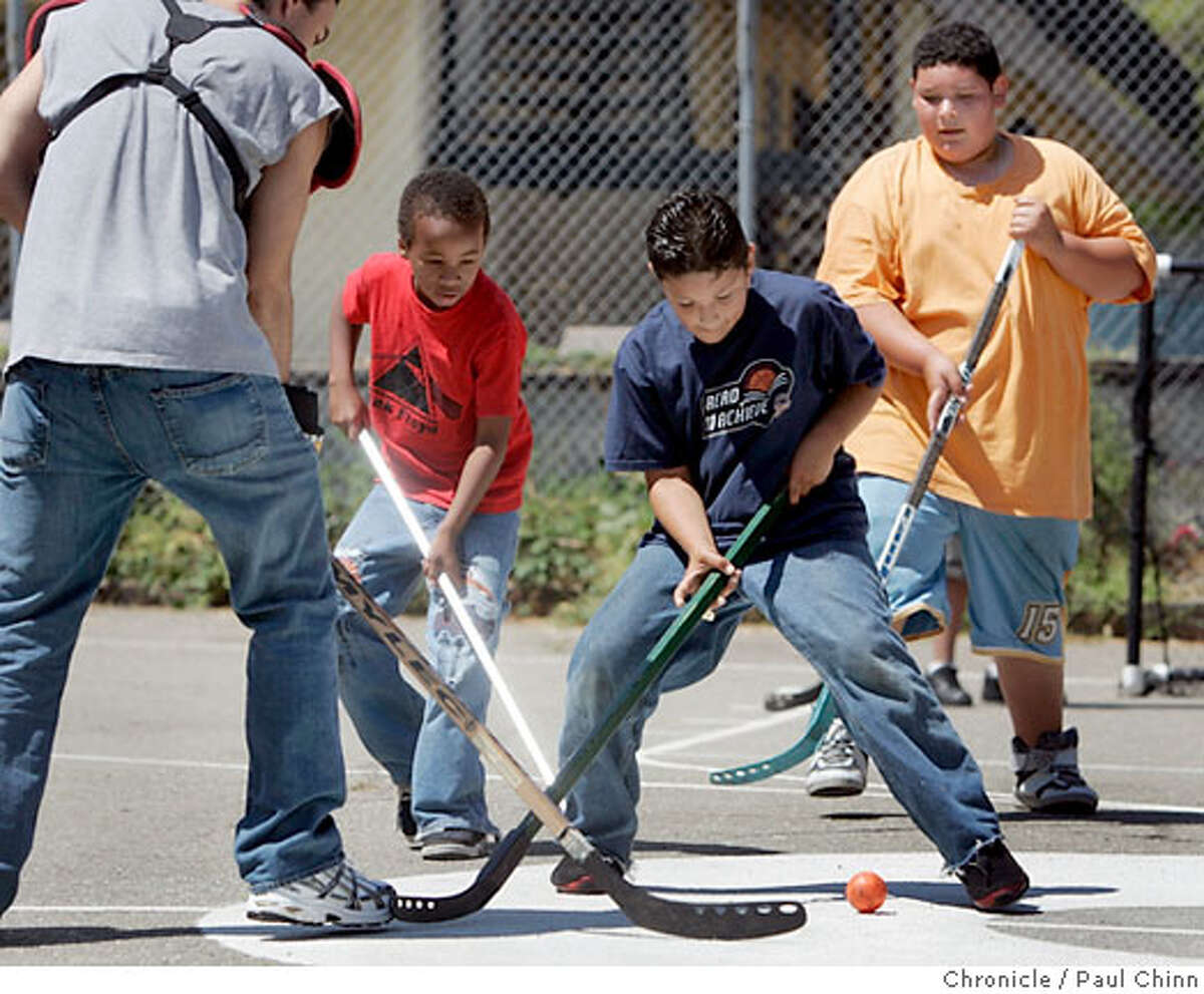 From left, Brian Libbe, Dillan Bradly, Daniel Munoz and Jesse Munoz play a game of street hockey at Harbor House community center in Oakland, Calif. on Wednesday, August 23, 2006. PAUL CHINN/The Chronicle **Brian Libbe, Dillan Bradly, Daniel Munoz, Jesse Munoz