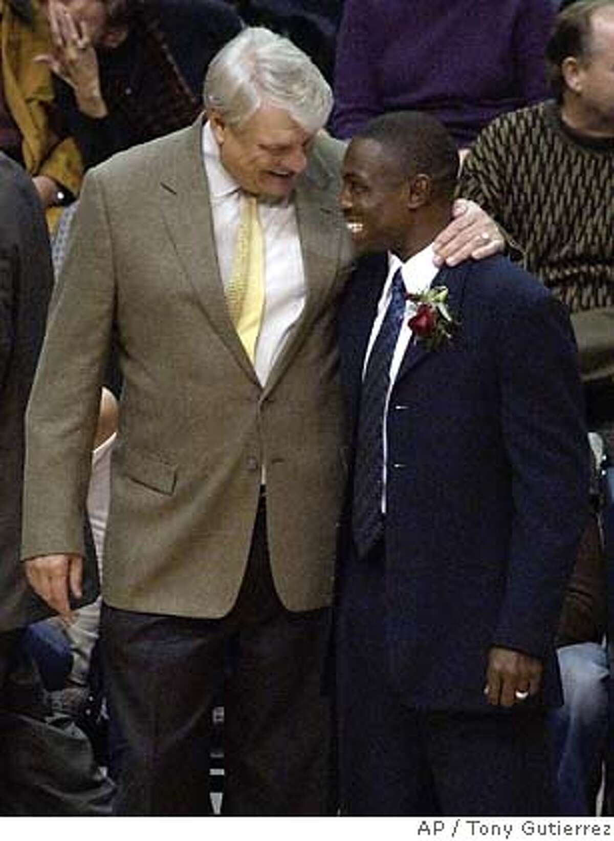 Dallas Mavericks head coach Don Nelson, left, gives assistant coach Avery Johnson, right, a smile and a hug just prior to the start of the game against the San Antonio Spurs, Tuesday, Nov. 30, 2004, in Dallas. Johnson was given the head coach responsiblities for the night as Nelson sat on the bench. (AP Photo/Tony Gutierrez) Ran on: 12-01-2004 Don Nelson offers advice to assistant coach Avery Johnson, who got his first training run as Mavericks head coach in a loss to the Spurs on Tuesday in San Antonio.